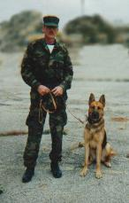Trainer John A Sampson I with scout dog Rex
